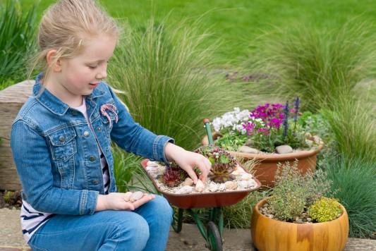 wpid17479-Child-Planting-Wheelbarrow-QCHI091-nicola-stocken.jpg