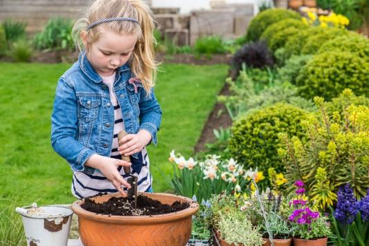 wpid17485-Child-Planting-Alpine-Bowl-QCHI061-nicola-stocken.jpg