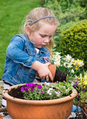 wpid17499-Child-Planting-Alpine-Bowl-QCHI068-nicola-stocken.jpg