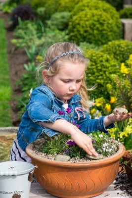 wpid17507-Child-Planting-Alpine-Bowl-QCHI073-nicola-stocken.jpg
