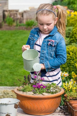 wpid17509-Child-Planting-Alpine-Bowl-QCHI074-nicola-stocken.jpg