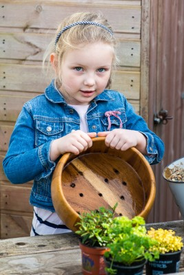 wpid17545-Child-Planting-Herb-Bowl-QCHI039-nicola-stocken.jpg